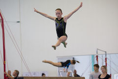Gymnastics Girl Beam Jump  Royalty Free Stock Photos