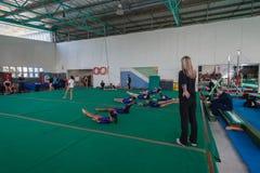 Gymnastics Young Girls Floor Coach Stock Images