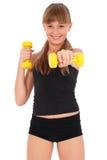 Gymnastikeignung-Mädchentraining ihre Karosserie mit Dumbbell Lizenzfreie Stockfotos