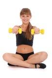 Gymnastikeignung-Mädchentraining ihre Karosserie mit Dumbbell Stockfotografie