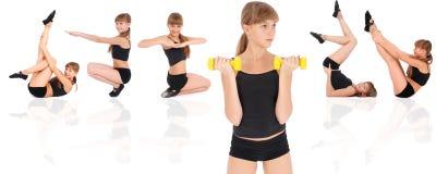 Gymnastikeignung-Mädchentraining ihre Karosserie mit Dumbbell Stockfoto