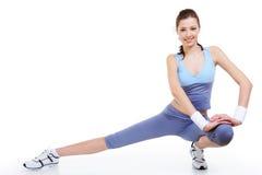 gymnastiskt posera kvinnan Arkivfoto
