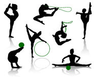 Gymnasts. Silhouettes of gymnasts with various sports subjects. A ball, a skipping rope, a hoop Stock Image