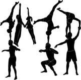 Gymnasts acrobats representation. People aerobics Stock Photo