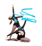 Gymnasts dancing with blue ribbons Stock Image