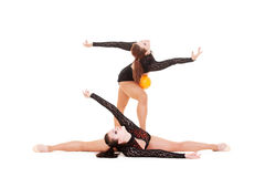 Gymnasts dancing with yellow ball Stock Photos
