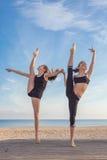 Gymnasts exercising pose Royalty Free Stock Photos