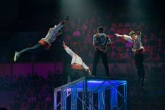 """Gymnasts jump on trampoline. MOSCOW, RUSSIA - NOVEMBER 16-17, 2018: Gymnasts performance at the """"Legends of Sport"""" show by Alexey Nemov - 2018 at the royalty free stock photography"""