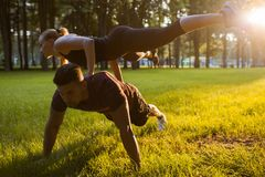 Gymnasts partners support sport outdoor training Stock Photos