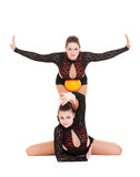 Gymnasts posing with yellow ball Royalty Free Stock Photography