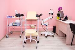 Gynecological cabinet with chair and other medical equipment in modern clinic. Equipment medicine, medical furniture. Hospital, genicology, women`s royalty free stock photos