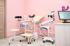 Gynecological cabinet with chair and other medical equipment in modern clinic. Equipment medicine, medical furniture. Hospital, genicology, women`s royalty free stock images