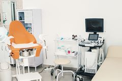 Gynecological cabinet with chair and other medical equipment. Room in the clinic with gynecological chair. Ultrasonic. Apparatus in the office of a gynecologist stock photos