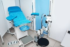 Gynecological clinic interior with chair. And medical equipment stock photo