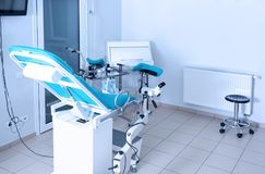 Gynecological room with chair. And equipment stock photo