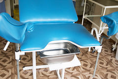 Gynecological room with chair and equipment. Photo of Gynecological room with chair and equipment Stock Photo
