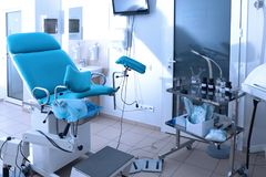 Gynecological room with chair. And equipment stock photos