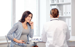 Gynecologist doctor and pregnant woman at hospital Royalty Free Stock Photography