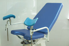 Gynecologist`s chair for examination. An armchair for inspection of girls in the gynecology room Royalty Free Stock Photo
