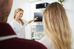 Gynecologist Showing Ultrasound Machine To Royalty Free Stock Image