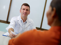 Gynecologist talking to woman in clinic Royalty Free Stock Photo
