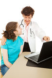Gynecologist and Teen Patient Stock Photos