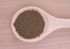 Gynostemma (jiaogulan) powder in wooden spoon Royalty Free Stock Images