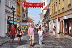 Gyor, Hungary. AUGUST 10, 2012: People visit old town in . In 2011 tourism receipts in Hungary brought 4.03 billion EUR to national economy Stock Photography
