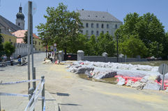 GYOR, HUNGARY/EUROPE - JUNE 8TH 2013: Sandbags Holding Back Flooding Danube River in Gyor, Hungary Royalty Free Stock Photo