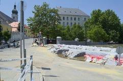 GYOR, HUNGARY/EUROPE - JUNE 8TH 2013: Sandbags Holding Back Flooding Danube River in Gyor, Hungary Royalty Free Stock Photo