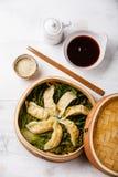 Gyoza dumpling in bamboo steamer and sauce Royalty Free Stock Photos