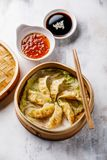 Gyoza dumpling in bamboo steamer and sauce Royalty Free Stock Photography