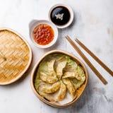 Gyoza dumpling in bamboo steamer and sauce Stock Image