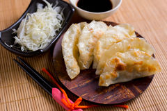 Gyoza dumplings on mini wooden dish, popular japanese food Royalty Free Stock Images