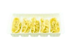 Gyoza dumplings in a white plastic PET (polyethylene terephthalate) container. Stock Photos