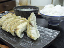 Gyoza with Egg Soup and Rice. Gyoza is A Japanese dish consisting of dumplings typically filled with ground meat and vegetables and grilled or fried Royalty Free Stock Images