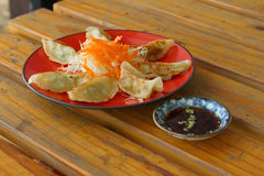 Gyoza in a red plate on a table Stock Photo