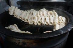 Gyozaen för krukaklistermärkear, kinesisk kokkonst, beskådar uppifrån Arkivbild