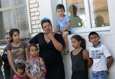 Gypsies children. Sofia, Bulgaria - July 30, 2015: Gypsies mothers and their children are attending at the official opening of a center in their neighborhood for Stock Photos