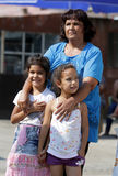Gypsies children. Sofia, Bulgaria - July 30, 2015: Gypsies children with their grandmother are attending at the official opening of a center in their Royalty Free Stock Images