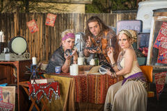 Gypsies with Lamp and Crystal Ball Royalty Free Stock Photos