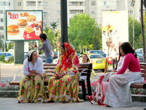 Gypsies talking. In the city center of Bacau Stock Photo