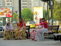 Gypsies talking. In the city center of Bacau Royalty Free Stock Photos