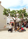 Gypsies and tourists in Saintes Maries de la Mer, France. Gypsies are arrived for the Gypsy`s Pilgrimage in Les Saintes Maries de la Mer in the French Camargue Royalty Free Stock Photography
