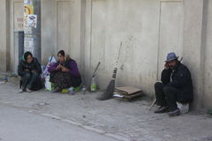 Gypsies. Two women and one man romanian gypsies sloth in Bucharest,Romania Royalty Free Stock Photos