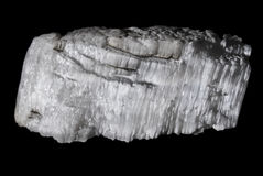 Gypsum. A piece of natural gypsum isolated on black background Royalty Free Stock Photography