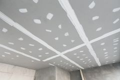 Gypsum board plaster ceiling of house under construction site. Gypsum board plaster ceiling of house under construction site Royalty Free Stock Image