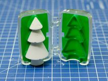 Gypsum christmas tree with mold. On the blue cutting mat royalty free stock photography