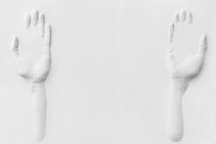 Gypsum hands offering something Royalty Free Stock Photography