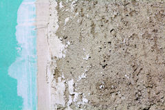 Gypsum plasterboard. Close up of a green gypsum plasterboard wall and cement plaster Royalty Free Stock Photo